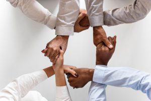 four-people-holds-hands-each-other